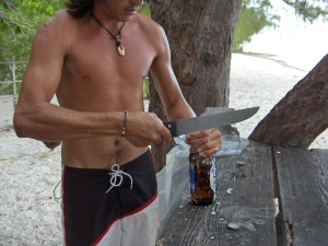 Tahitian bottle opener. Check out the scars on his arm!