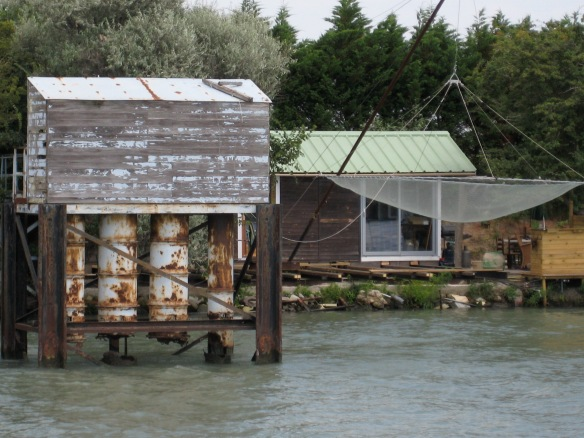 A home with a large fishing net along the Petit Rhone